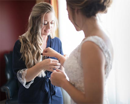 Bride and Bridesmaid Getting Ready - Photography by Maria Silva-Goya